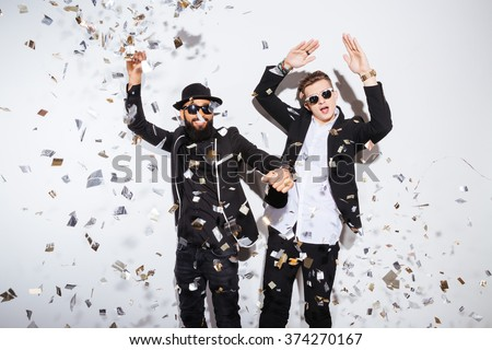 Two young men dancing on party - stock photo