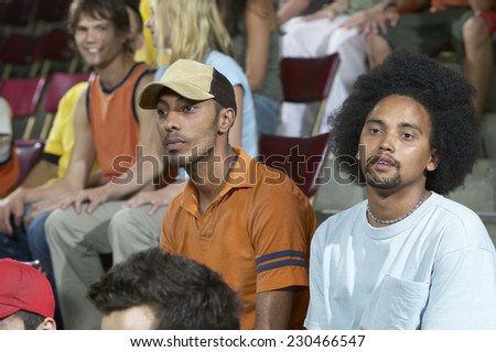 Two Young Men Watching a Sporting Event - stock photo