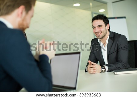 Two young men working in the office - stock photo