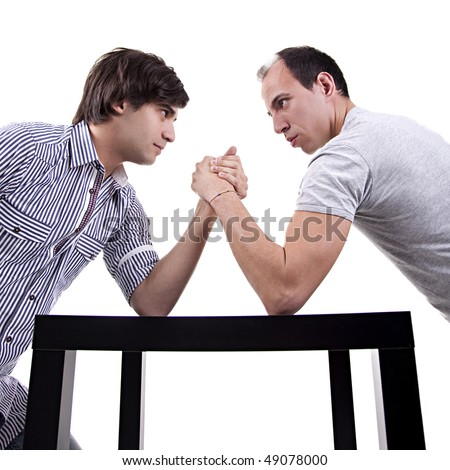 two young men wrestling - stock photo