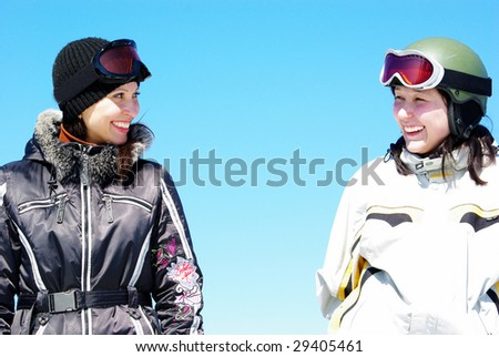 Two young mountain-skiers smiling - stock photo