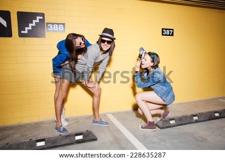 Two young naughty girls and one guy having fun. Lifestyle - stock photo
