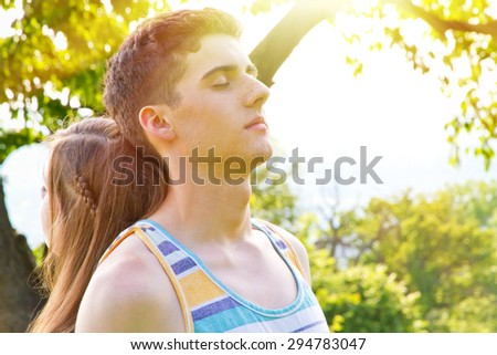 Two young people enjoy the sun - stock photo