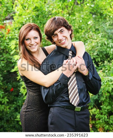 two young people hugging outside - stock photo