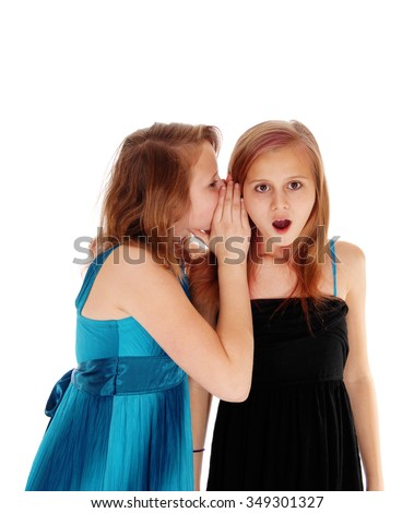 Two young pretty sisters sharing some secrets, one whispering in the ear
