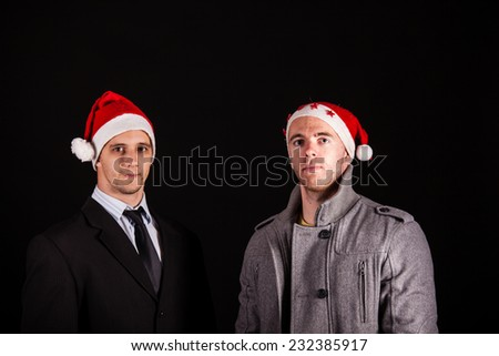 Two young santa claus businessman - stock photo