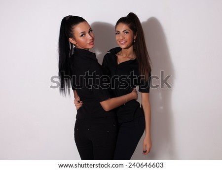 two young sexy woman on white background.  - stock photo