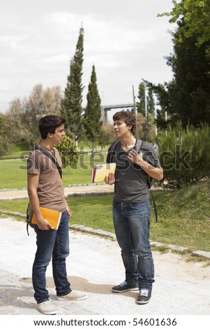 two young student talking at the school park - stock photo