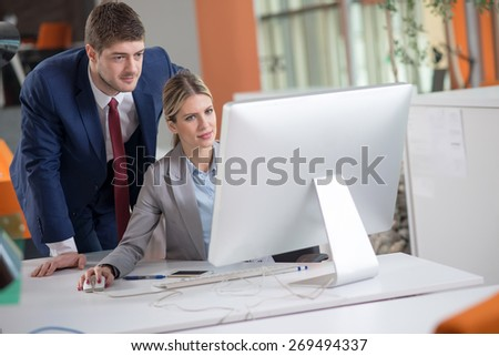 Two young successful business people in the office  - stock photo