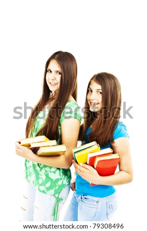 Two young teenage girls with colored books - stock photo