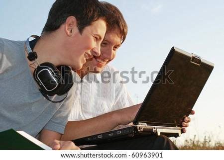 two young teenager enjoying study - stock photo