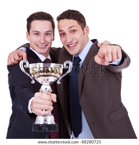 two young winning business men pointing to you, over white background - stock photo