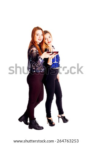 Two young woman cheering with red wine - isolated on white. - stock photo