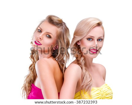Two young woman friends portrait isolated on white background - stock photo
