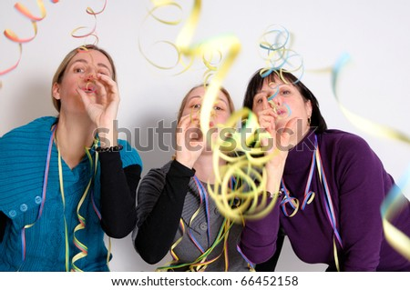 Two young women and one senior woman celebrating New year's eve. Shot taken in front of white background - stock photo