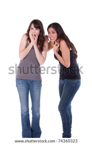 Two young women, casually dressed, looking terrified. - stock photo