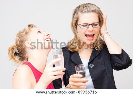 Two young women enjoying party. - stock photo