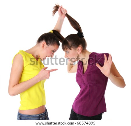 Two young women fighting. Isolated at white background - stock photo
