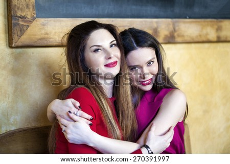 Two young women having lunch break together in a coffee shop - stock photo