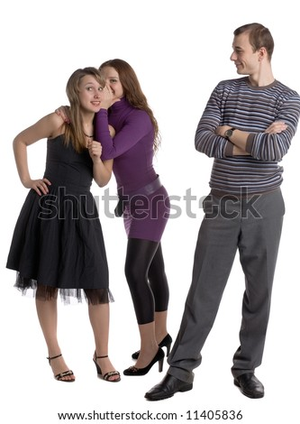 two young women whispering about a man standing before them isolated on white - stock photo