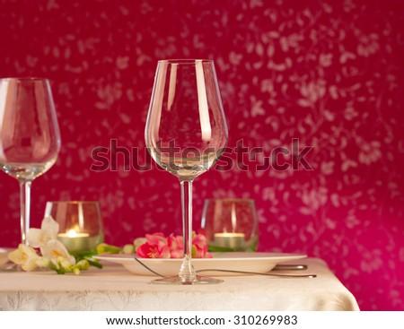 Twoo empty wine glasses on table - stock photo