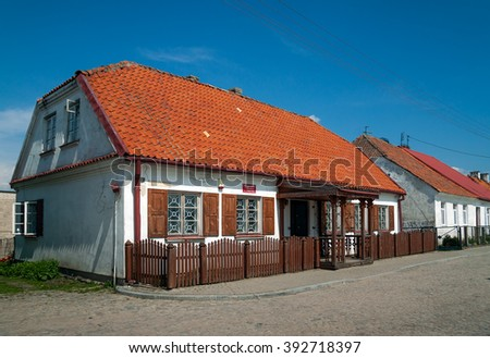 TYKOCIN, POLAND - MAY 10, 2010:  Civil Registry house, traditional buildings at Czarnecki Square - stock photo