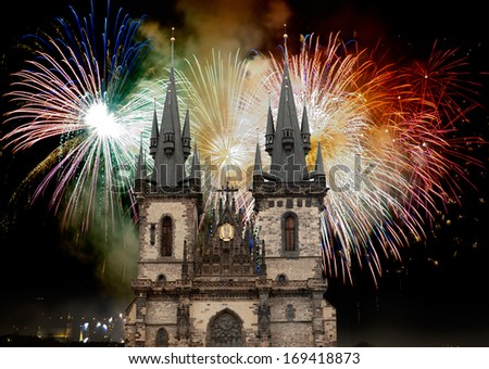 Tyn Church in Prague on the background of the New Year fireworks - stock photo