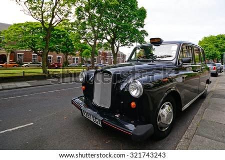 TYNEMOUTH - 15 JUNE : Taxi at 15 June 2015 in Tynemouth, England. Taxis in England are mainly old-fashioned cars. - stock photo