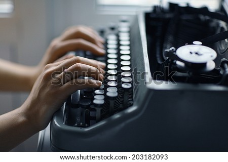 typewriter girl hands - stock photo