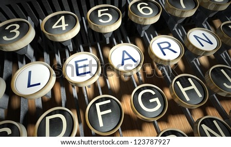 Typewriter with Learn buttons, vintage style - stock photo