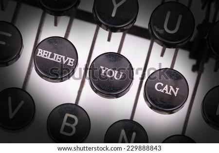 Typewriter with special buttons, believe you can - stock photo