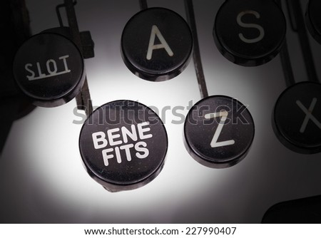 Typewriter with special buttons, benefits - stock photo
