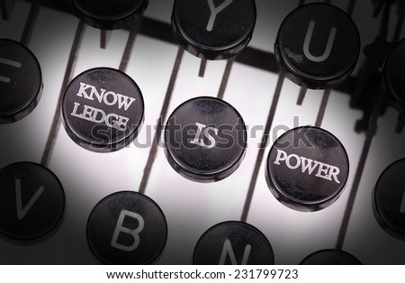 Typewriter with special buttons, knowledge is power - stock photo