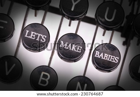 Typewriter with special buttons, lets make babies - stock photo