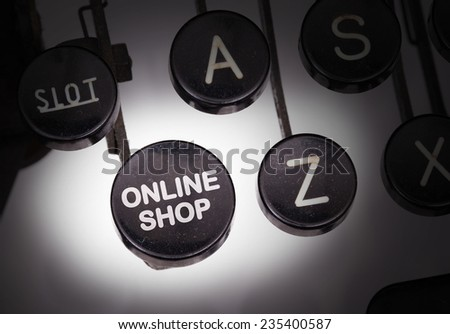 Typewriter with special buttons, online shop - stock photo