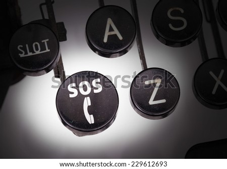 Typewriter with special buttons, SOS - stock photo