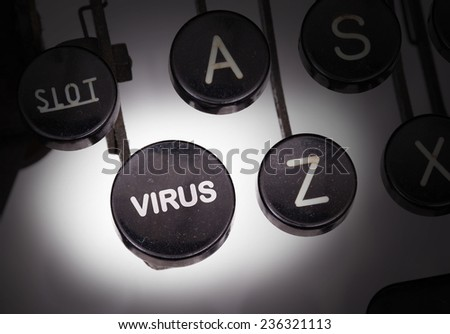 Typewriter with special buttons, virus - stock photo