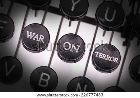 Typewriter with special buttons, war on terror - stock photo