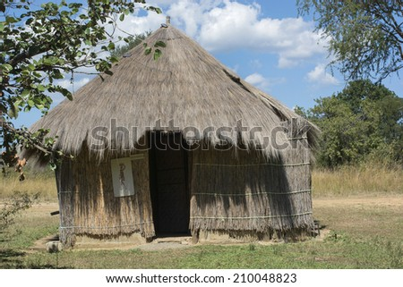 typical African hut made of straw - stock photo