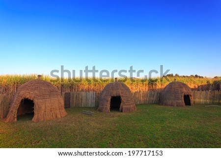 Typical African thatched cottages in Swaziland  - stock photo