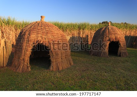 Typical African thatched huts in  Swaziland - stock photo