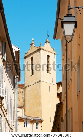 Typical Aix en Provence street view with ancient tower from XVI century and old houses - stock photo
