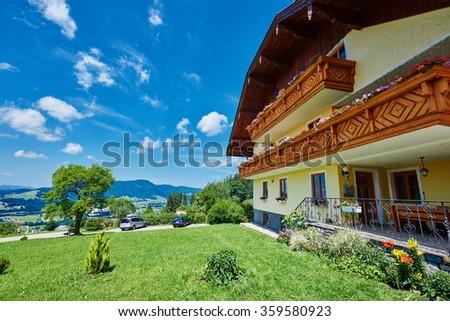 typical alpine guest house in summer season, near mondsee lake, Austria  - stock photo