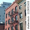 Typical American-style steel fire escapes downtown Manhattan, New York City. - stock photo