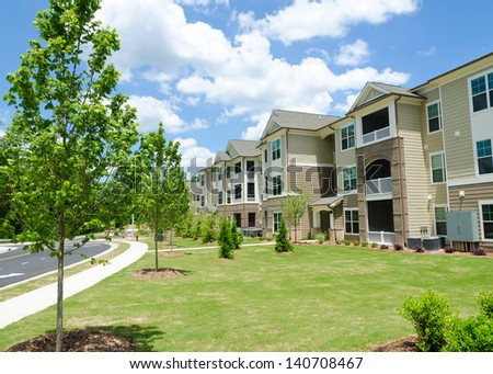 Typical apartment complex building in suburban area - stock photo