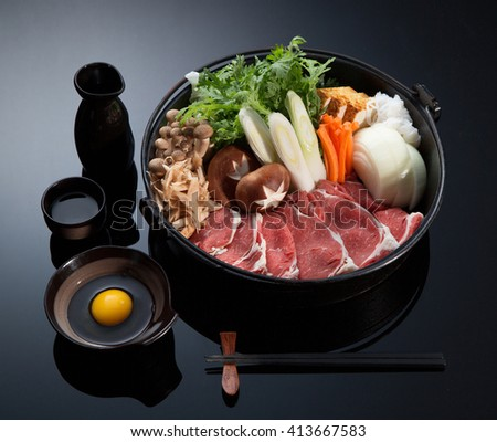 Typical Asian ingridients: marble noodles, bacon, tofu, mushrooms, onion and greens preparing in a casserole ready to preapare. Asian food. - stock photo