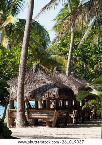 Typical bamboo huts on a Philippines Beach - stock photo