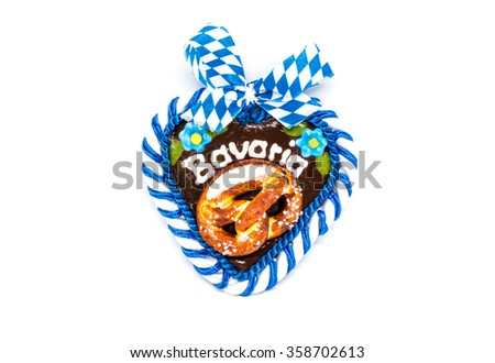 typical bavarian oktoberfest heart with clipping path on white - stock photo