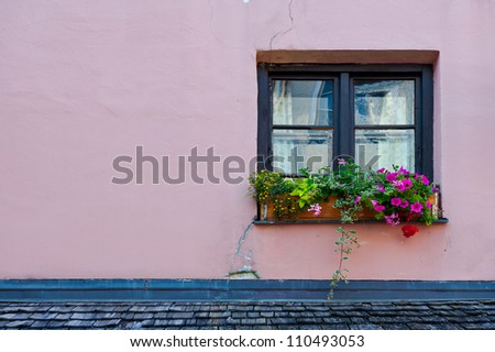 Typical Bavarian Window  Decorated With Fresh Flowers - stock photo