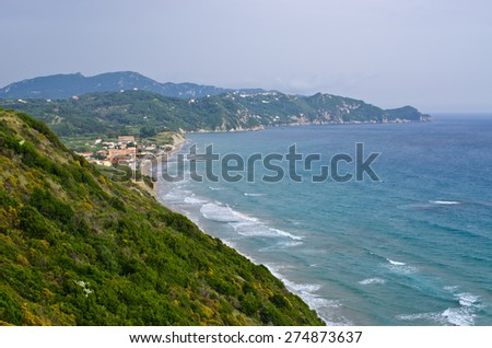 Typical bay with little town Arillas on Corfu, Greece - stock photo